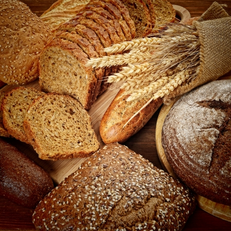 healthy grains: fresh bread  and wheat on the wooden