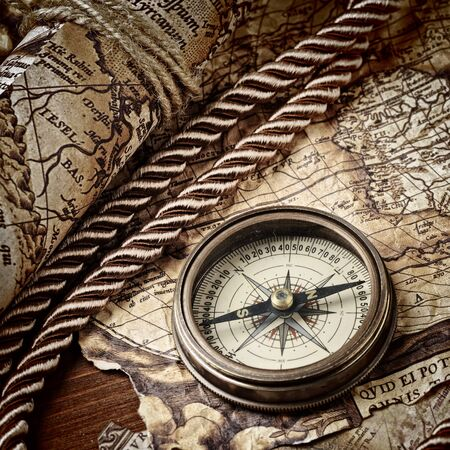vintage  still life with compass and old map photo