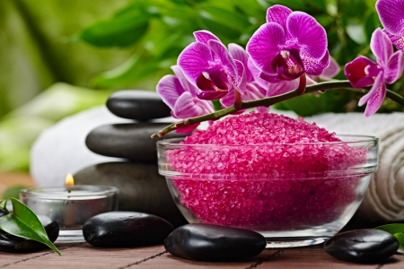 spa candles: zen basalt stones and orchid on the wood Stock Photo