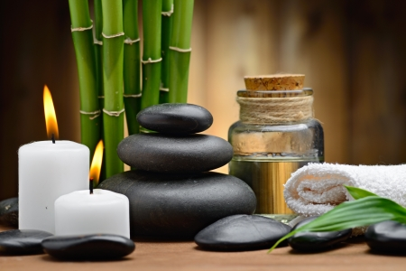 ayurvedic: zen basalt stones and spa oil on the wood Stock Photo