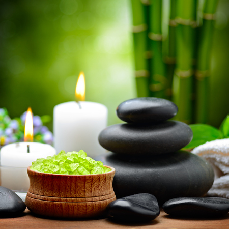 crystal bowl: spa composition with lime and toning sea crystals Stock Photo