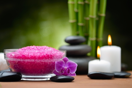 crystal therapy: zen basalt stones and orchid on the wood Stock Photo