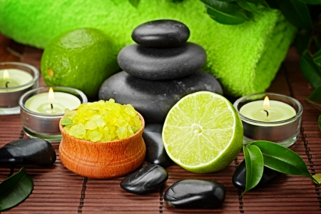 candles spa: spa composition with lime and toning sea crystals Stock Photo
