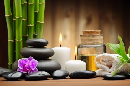 aromatherapy oils: zen basalt stones and orchid on the wood Stock Photo