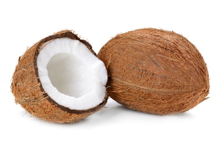 Coconut flakes with coconut in wooden bowl on the white background photo