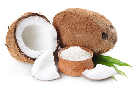 Coconut flakes with coconut in wooden bowl on the white background Banco de Imagens - 25641439