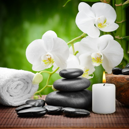 white orchid: zen basalt stones and orchid on the wood Stock Photo