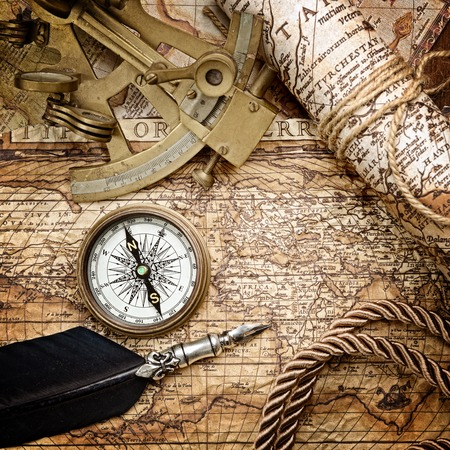books on a wooden surface: vintage  still life with compass,sextant and old map Stock Photo