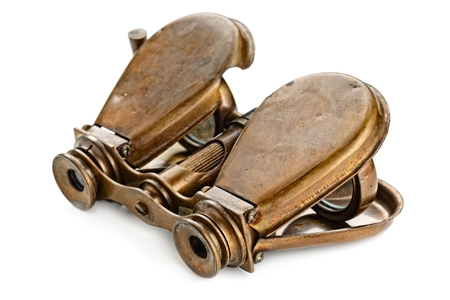 antique binoculars: vintage binoculars isolated on white Stock Photo