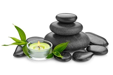 zen stones: zen basalt stones and candle isolated on white