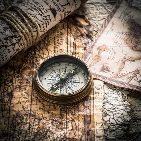 vintage  still life with compass on the old map photo
