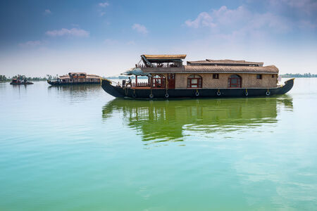kerala culture: Traditional Inian house boat .Kerala Editorial