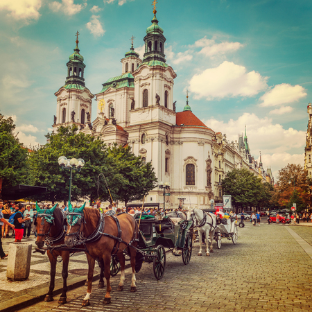 brougham: Horse Carriage and Church of Saint Nicholas (Saint Nicholas Cathedral) at Old Town Square.Prague   Editorial
