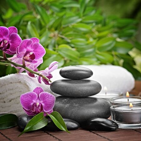 green orchid: zen basalt stones and orchid Stock Photo