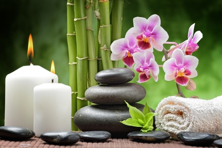 spa concept with zen basalt stones and orchid photo
