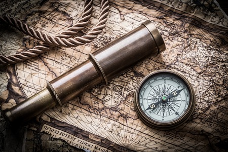vintage  still life with compass,sextant spyglass and old map photo