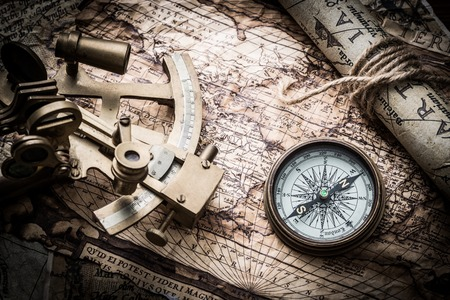 books on a wooden surface: vintage  still life with compass,sextant spyglass and old map Stock Photo