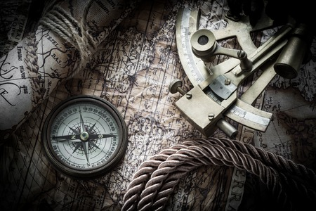 vintage  still life with compass,sextant and old map. map of the 1570 photo