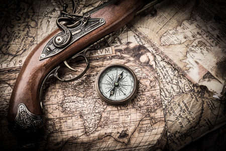 vintage gun: vintage  still life with compass,sextant and old map. map of the 1570