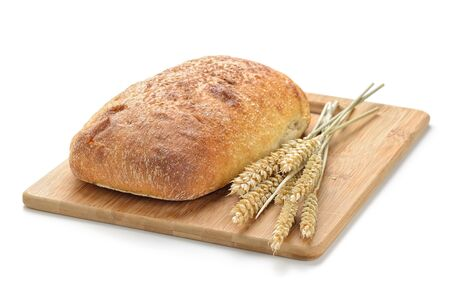 life loaf: fresh bread  and wheat on white