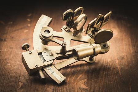 longitude: old bronze sextant on the white background Stock Photo