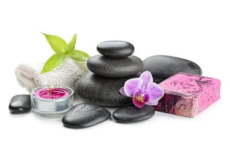 black stone: zen basalt stones,soap and orchid isolated on white