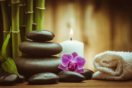 zen spa: spa concept with zen basalt stones and orchid Stock Photo