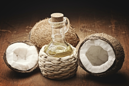 shredded coconut: coconut oil  on the wooden background