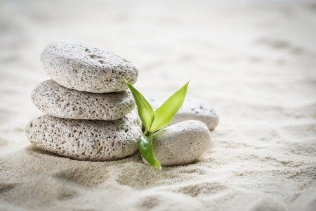 zen  stones and bamboo on the sand photo