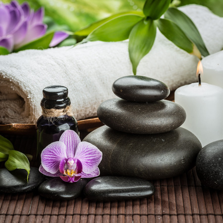 spa concept with zen basalt stones and massage oil photo