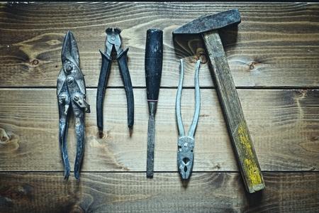grange: old tools on wooden background