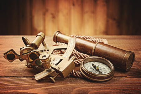 vintage  still life with compass,sextant and spyglass photo