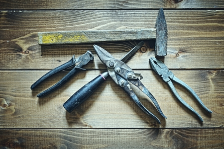 tool kit: old tools on wooden background