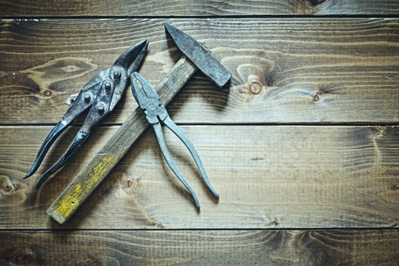 old tools on wooden background photo