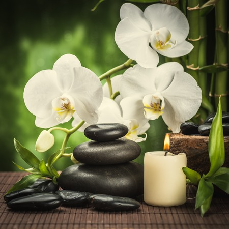 spa concept zen basalt stones ,orchid and candle photo