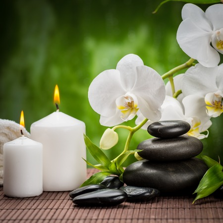 black stones: spa concept zen basalt stones ,orchid and candle