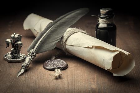 papel viejo y pluma