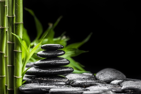 zen basalt stones and bamboo on the black photo