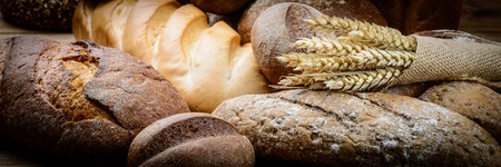 baking bread: fresh bread  and wheat on the wooden