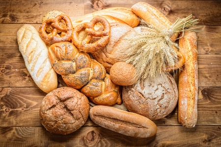 life loaf: fresh bread  and wheat on the wooden
