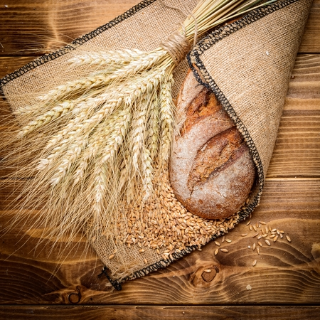 wheat: fresh bread  and wheat on the wooden