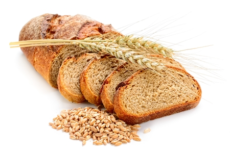 fresh sliced bread  and wheat on white