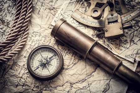 vintage still life with compass,sextant spyglass and old map 免版税图像