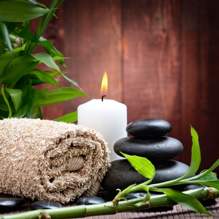votive candle: spa still life with zen basalt stones ,votive candle and  bamboo Stock Photo