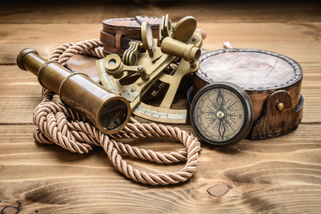 old vintage: vintage still life with compass,sextant and spyglass Stock Photo