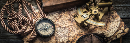 vintage still life with compass,sextant and spyglass Standard-Bild