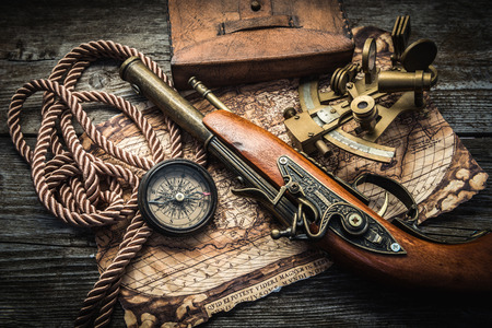 weapon: vintage  still life with compass,sextant and pistol Stock Photo