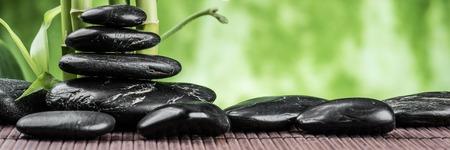arboleda: concepto de spa con piedras de basalto de Zen