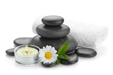 spa still life with zen basalt stones ,daisy and bamboo with candle on the white Stock Photo