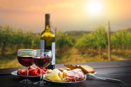 still life Red wine ,cheese and prosciutto. Romantic dinner outdoors Stock fotó - 72827659